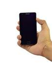Un control de la mano un teléfono móvil del fondo blanco Fotografía de archivo