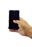 Un control de la mano un teléfono móvil del fondo blanco Fotos de archivo
