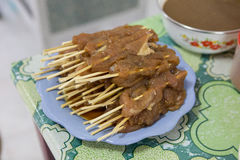 Un-cook Asian style Barbecue pork. Stab with wood stick Stock Image
