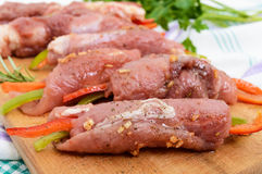 Un-cooked, pork meat rolls stuffed with vegetables Royalty Free Stock Image