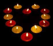 Un corazón de velas coloreadas Imagen de archivo libre de regalías