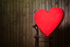 Un corazón grande en la silla Imagen de archivo libre de regalías
