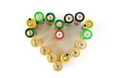 Un corazón hecho de las baterías del AA aisladas Fotografía de archivo