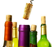 Un corked. Colorful wine bottles and corks closeup on white Royalty Free Stock Photography