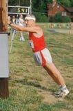 Un corredor que se prepara para una raza Imágenes de archivo libres de regalías