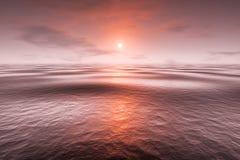 Un coucher du soleil rouge au-dessus de la mer Photo libre de droits