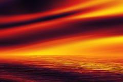 Un coucher du soleil rouge au-dessus de la mer Photographie stock