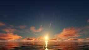 Un coucher du soleil rouge dans l'océan Photos stock
