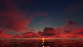 Un coucher du soleil rouge foncé dans l'océan Photo libre de droits