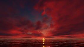 Un coucher du soleil rouge foncé dans l'océan Images stock