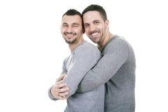 Un couple homosexuel au-dessus d'un fond blanc Images libres de droits