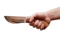 Un couteau dans une main Image stock