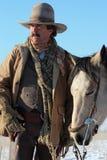 Un cowboy et son cheval Image stock