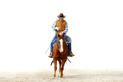 Un cowboy montant son cheval, backgrou blanc d'isolement Photos libres de droits