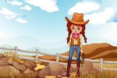 Un cowgirl grazioso vicino alle rocce Fotografie Stock