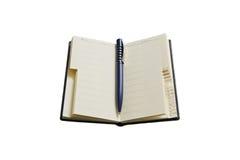 Un crayon lecteur et un carnet d'adresses Image stock