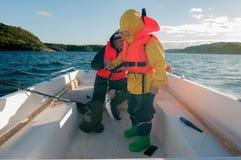 Un crochet de la visite de pêche avec le faher Images libres de droits