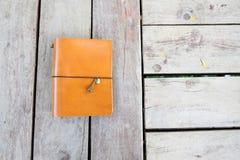 Un cuaderno anaranjado Fotos de archivo libres de regalías