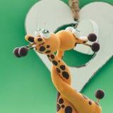 Un cuore bianco per due giraffe Fotografia Stock