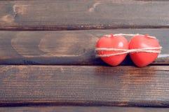Un cuore di due colori rossi Immagine Stock