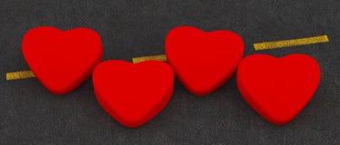 Un cuore di quattro rossi Fotografie Stock