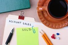 Un dépliant de ventes de compte image stock