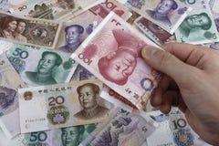 Un día en China (dinero chino RMB) Fotos de archivo