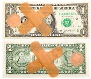 Un dólar con band-aid Imagen de archivo libre de regalías