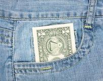 Un dólar en bolsillo Imágenes de archivo libres de regalías