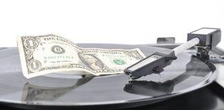 Un dólar que miente en un viejo jugador de registro en una placa Fotos de archivo libres de regalías