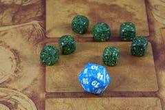 Un dado azul claro con el verde siete corta en cuadritos Foto de archivo libre de regalías
