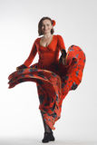 Un dancing della donna in vestito rosso Fotografia Stock Libera da Diritti