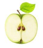 Un demi- de la pomme verte coupée en tranches d'isolement sur un backgroun blanc Photos libres de droits