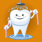Un dente con filo per i denti Immagini Stock