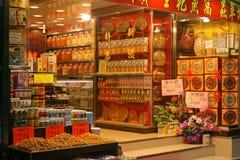 Un deposito della medicina di cinese tradizionale sulle vie di Hong Kong Fotografie Stock Libere da Diritti