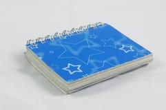 Un diario azul Imágenes de archivo libres de regalías