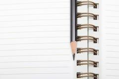 Un diario e una matita Fotografie Stock Libere da Diritti