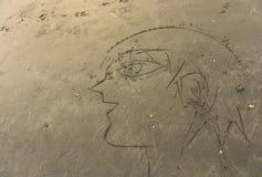 Un dibujo de una gente en la arena fotografía de archivo libre de regalías