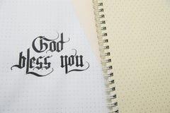 Un dieu des textes vous bénissent sur la texture de papier de note Photo libre de droits