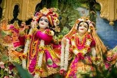Un dieu indou Krishna avec son épouse Radha Photographie stock libre de droits