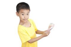 Un dinero de la toma del niño Fotografía de archivo libre de regalías