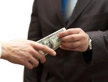 Un dinero de manos del hombre al hombre de negocios Imágenes de archivo libres de regalías