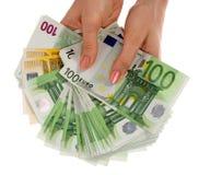 Un dinero está en manos. Imagen de archivo libre de regalías