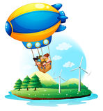 Un dirigible con los niños que pasan sobre una isla Foto de archivo