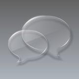 Un discorso di vetro di due bolle su fondo grigio. Fotografie Stock