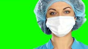 Un doctor de sexo femenino With A Stethoscope Listening almacen de video