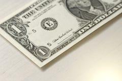 Un dollar avec une note 1 dollars Images libres de droits