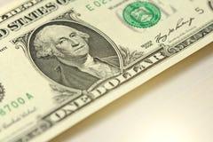 Un dollar avec une note 1 dollars Image stock