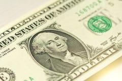Un dollaro con una nota 1 dollaro Fotografie Stock Libere da Diritti