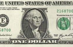 Un dollaro con una nota 1 dollaro Fotografia Stock Libera da Diritti